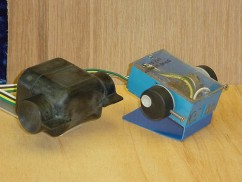 Functional Prototype (Blue) - made with off the shelf parts.  1st Run Prototype (Black) - Machined from Delrin plastic.